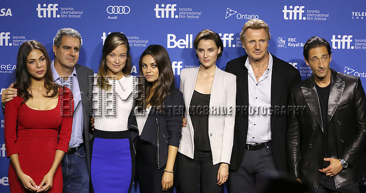 """Moran Atias, producer Michael Nozik, Olivia Wilde, Mila Kunis, Paul Haggis, Loan Chabanol, Liam Neeson and Adrien Brody attending the 2013 Tiff Film Festival Photo Call for """"Third Person""""  at the Tiff Bell Lightbox on September 10, 2013 in Toronto, Canada."""