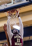 WATERBURY, CT. 09 December 2018-120918 - Sacred Heart forward Jammal Waters #11 gets an put back for a dunk during the annual Waterbury Boys Basketball Jamboree at Kennedy High School in Waterbury on Sunday. Bill Shettle Republican-American