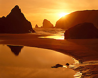 Sunset at low tide on the Oregon coast below Goat Island; Harris Beach State Park, OR