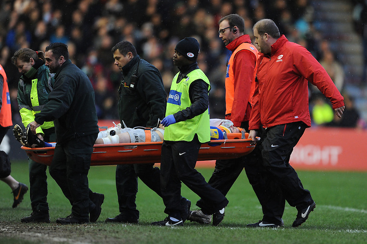 George Kruis of Saracens is stretchered off during the Premiership Rugby match between Harlequins and Saracens - 09/01/2016 - Twickenham Stoop, London<br /> Mandatory Credit: Rob Munro/Stewart Communications