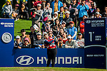 Ha-Na Jang of Korea plays a shot as a gallery of fans watch during the Hyundai China Ladies Open 2014 at World Cup Course in Mission Hills Shenzhen on December 14  2014, in Shenzhen, China. Photo by Xaume Olleros / Power Sport Images