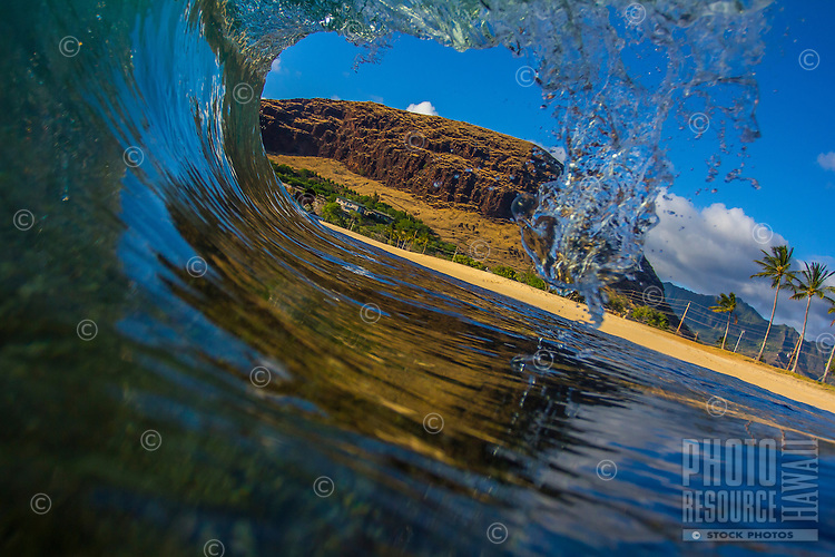 Looking out of a wave on a sunny day in West O'ahu.