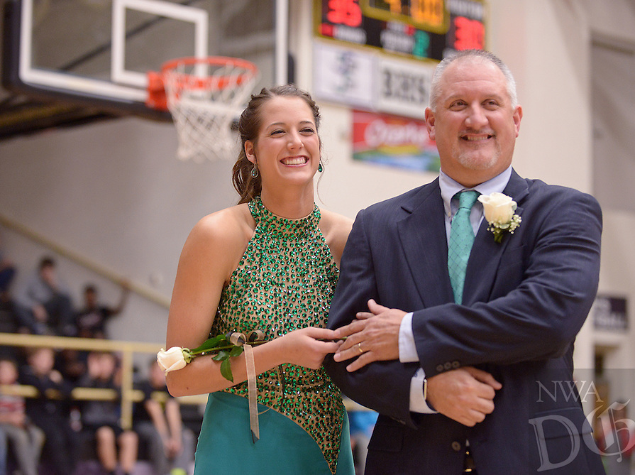 NWA Democrat-Gazette/BEN GOFF @NWABENGOFF<br /> Madison Brittain, with father Mark Brittain, reacts after being named Bentonville High Colors Day Queen on Friday Jan. 15, 2016 during Bentonville High's colors day ceremony at halftime in the boys basketball game against Springdale Har-Ber in Bentonville's Tiger Arena.