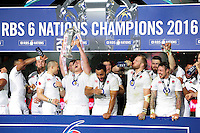 England players celebrate as captain Dylan Hartley lifts the Six Nations trophy. RBS Six Nations match between France and England on March 19, 2016 at the Stade de France in Paris, France. Photo by: Patrick Khachfe / Onside Images