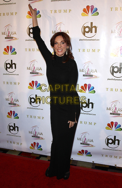 Marilu Henner.2012 Miss USA Pageant red carpet arrivals at Planet Hollywood Resort and Casino, Las Vegas, Nevada, USA..3rd June 2012.full length dress hand arm in air  black  .CAP/ADM/MJT.© MJT/AdMedia/Capital Pictures.