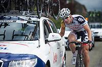J&uuml;rgen Roelandts (BEL) checking in with DS Bart Leysen<br /> <br /> 2013 Ster ZLM Tour <br /> stage 4: Verviers - La Gileppe (186km)