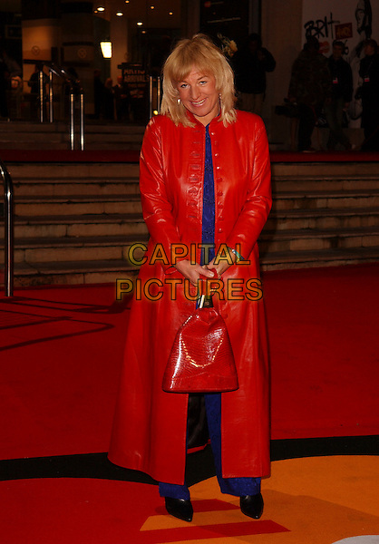 CAROL THATCHER.The Brit Awards 2006.Earls Court, London England.15 February 2006.Ref: FIN.earl's pop music brits full length red leather jacket coat purse bag.www.capitalpictures.com.sales@capitalpictures.com.© Capital Pictures.