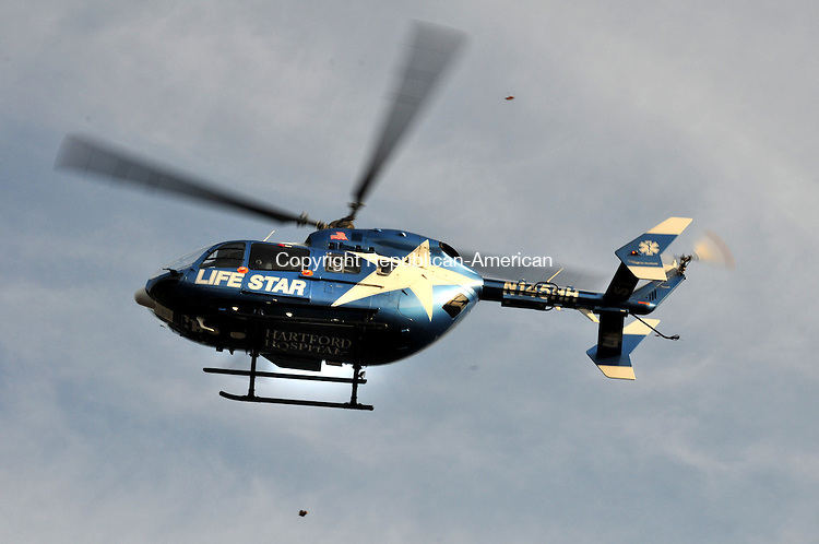WINSTED, CT, 03 DEC 11-120311AJ01- A LifeStar helicopter takes off on Saturday in Winsted carrying a patient with a serious head injury to Hartford Hospital. Alec Johnson / Republican-American