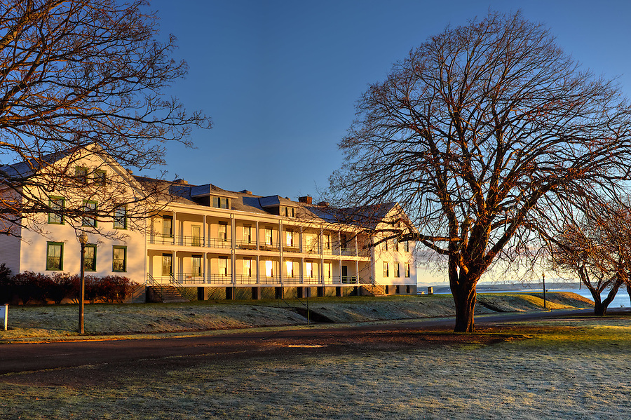 Sun rises on old headquarters barracks, Fort Worden State Park, Port Townsend, Washington, USA
