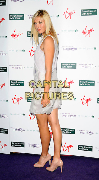 MARIA SHARAPOVA .The Pre-Wimbledon party, Roof Gardens, kensington, London, England..June 19th, 2008.full length grey gray dress sleeveless looking over shoulder pink beige shoes heels .CAP/CAN.©Can Nguyen/Capital Pictures.