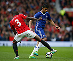 Diego Costa of Chelsea tracked by Eric Bailly of Manchester United during the English Premier League match at Old Trafford Stadium, Manchester. Picture date: April 16th 2017. Pic credit should read: Simon Bellis/Sportimage