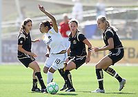 24 May 2009: Marta of the Los Angeles Sol dribbles the ball away from FC Gold Pride defenders during the game at Buck Shaw Stadium in Santa Clara, California.  Los Angeles Sol defeated FC Gold Pride, 2-0.