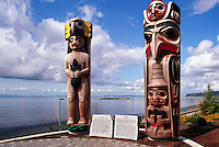White Rock, BC, British Columbia, Canada - Coast Salish and Haida Totem Poles in Lions Park, along Seaside Promenade Walkway and Semiahmoo Bay