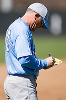 North Carolina Tar Heels head coach Mike Fox makes notes on his lineup card at the 2008 Coca-Cola Classic at the Winthrop Ballpark in Rock Hill, SC, Sunday, March 2, 2008.
