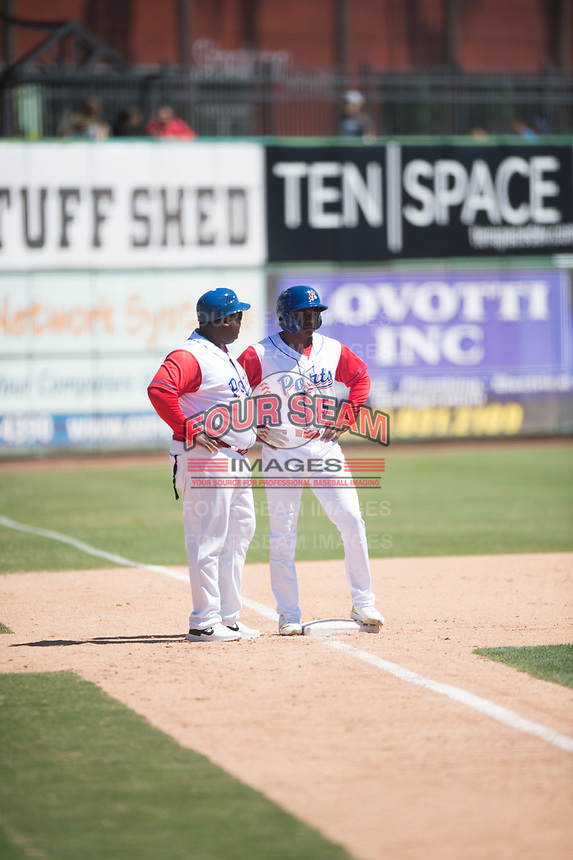 Stockton Ports center fielder Jameson Hannah (5) talks to manager Webster Garrison (30) during a California League game against the San Jose Giants on April 9, 2019 in Stockton, California. San Jose defeated Stockton 4-3. (Zachary Lucy/Four Seam Images)