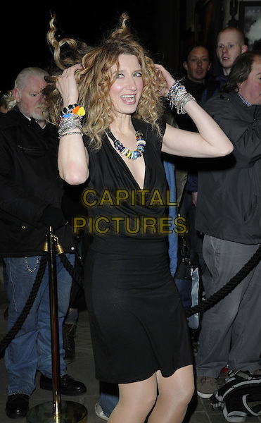 "Melanie Masson.The ""Macbeth"" press night performance, Trafalgar Studios, Whitehall, London, England..February 22nd, 2013.half length black cowl neck sleeveless dress smiling hands arms mouth open bracelets necklace silver hair funny .CAP/CAN.©Can Nguyen/Capital Pictures."