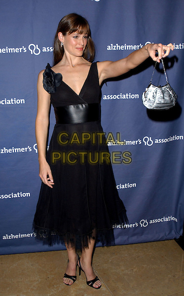 """JENNIFER GARNER.The Alzheimer's Association's 12th Annual """"A Night at Sardi's"""" Celebrity Fundraiser held at The Beverly Hilton Hotel in Beverly Hills, California .04 March 2004.*UK Sales Only*.full length, full-length, little black fifties style dress, sandals, shoes, heels, silver ruched handbag, pointing.www.capitalpictures.com.sales@capitalpictures.com.©Capital Pictures."""