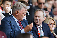(L-R) John Toshack talks to the new Swansea Chairman Trevor Birch during the Sky Bet Championship match between Swansea City and Rotherham United at the Liberty Stadium, Swansea, Wales, UK. Friday 19 April 2019
