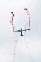 Swift aerobatic team glider display at the Farnborough International Airshow .
