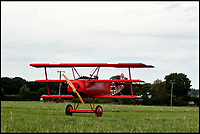 BNPS.co.uk (01202 558833)<br /> Pic: RobHenry/BNPS<br /> <br /> Touchdown - Peter returns to earth.<br /> <br /> The feared Fokker Dreidecker of the Red Baron has finally flown over Britian skies - after British based German doctor 'Baron' Peter von Brueggemann spent 9 years building a replica in his garage.<br /> <br /> The German GP based in Norfolk has spent 9 years building a Fokker triplane as a tribute to infamous WW1 Ace Manfred von Ricthofen, who terrorised the skies over the Western front during the first war.<br /> <br /> Dr Peter Brueggemann, 53, fufilled his childhood dream and emulated the notorious German fighter Ace when his hand built Dreidecker finally took off this week.<br /> <br /> Dr Brueggemann has even acquired the title Baron from the independent territory of Sealand so he can take to the skies as Baron Peter von Brueggemann in homage to his idol.<br /> <br /> The GP at the Holt Medical Practice in Norfolk finally reached for the sky at Felthorpe airfield near Norwich this week in front of nervous friends and family after thousands of hours spent crafting the aircraft.<br /> <br /> The father-of-two, who has lived in England with wife Sue for 20 years, has been taking flying lessons since his project began.