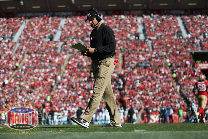 SAN FRANCISCO, CA - NOVEMBER 10:  Head coach Jim Harbaugh of the San Francisco 49ers walks the sidelines during the game against the Carolina Panthers at Candlestick Park on November 10, 2013 in San Francisco, California. (Photo by Brad Mangin)