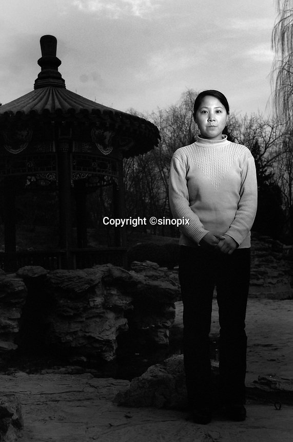 Jin Yani, 28, poses in a park in Beijing. Yani was nine months pregnant when a gang from the Birth Control Unit smashed into her house and dragged to the local clinic where her baby was injected with poison, killed and then aborted.