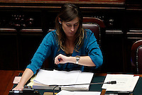 Il Ministro per le Riforme Costituzionali ed i Rapporti con il Parlamento Maria Elena Boschi guarda l'orologio durante la discussione sul disegno di legge della riforma del sistema elettorale, alla Camera dei Deputati, Roma, 10 marzo 2014.<br /> Italian Constitutional Reforms and Relations with Parliament Minister Maria Elena Boschi checks the time during the discussion on the new electoral law, at the Lower Chamber in Rome, 10 March 2014.<br /> UPDATE IMAGES PRESS/Riccardo De Luca