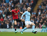 Ander Herrera of Manchester United leaps into a tackle on  David Silva of Manchester City during the premier league match at the Etihad Stadium, Manchester. Picture date 7th April 2018. Picture credit should read: Simon Bellis/Sportimage