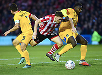Lincoln City's Shay McCartan is stopped in his tracks by Northampton Town's David Buchanan, left, and Hakeem Odoffin<br /> <br /> Photographer Andrew Vaughan/CameraSport<br /> <br /> Emirates FA Cup First Round - Lincoln City v Northampton Town - Saturday 10th November 2018 - Sincil Bank - Lincoln<br />  <br /> World Copyright © 2018 CameraSport. All rights reserved. 43 Linden Ave. Countesthorpe. Leicester. England. LE8 5PG - Tel: +44 (0) 116 277 4147 - admin@camerasport.com - www.camerasport.com