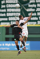 June 15, 2005; Washington, DC, USA; DC United's Dema Kovalenko (21) collides with the Chicago Fire's Gonzalo Segares (25)  at RFK Stadium. DC United  won the game, 4-3.