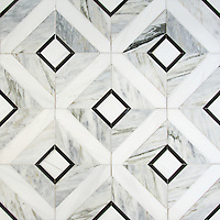 Hadrian, a hand-cut stone mosaic, shown in polished Cirrus, Dolomite, and Nero Marquina, is part of the Palazzo™ collection by New Ravenna.