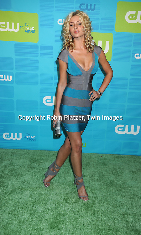"Aly Michalka of ""Hellcats"" in Herve Leger dress posing for photographers at the CW Network 2010 Upfront on May 20, 2010 at Madison Square Garden in New York City."