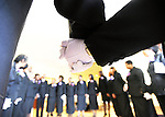 Ushers for the Metropolitan Baptist Church gather to pray before the 9:30 service on Sunday morning at their temporary church at Capts Academy Charter School in Northwest Washington, D.C..