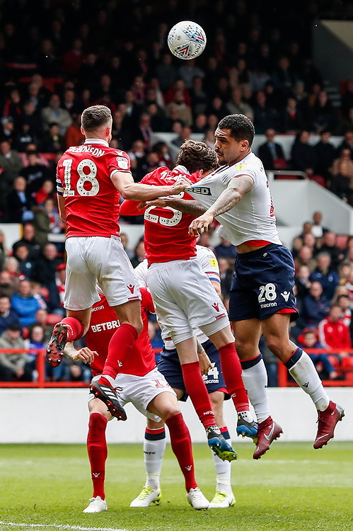 Bolton Wanderers' Josh Magennis competing with Nottingham Forest's Jack Robinson <br /> <br /> Photographer Andrew Kearns/CameraSport<br /> <br /> The EFL Sky Bet Championship - Nottingham Forest v Bolton Wanderers - Sunday 5th May 2019 - The City Ground - Nottingham<br /> <br /> World Copyright © 2019 CameraSport. All rights reserved. 43 Linden Ave. Countesthorpe. Leicester. England. LE8 5PG - Tel: +44 (0) 116 277 4147 - admin@camerasport.com - www.camerasport.com