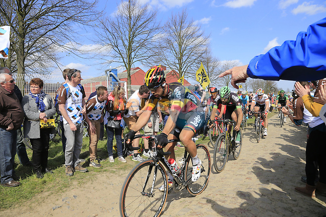 The peloton including Belgian Champion Jens Debusschere (BEL) Lotto-Soudal tackle Sector 10 Mons-en-Pevele during the 113th edition of the Paris-Roubaix 2015 cycle race held over the cobbled roads of Northern France. 12th April 2015.<br /> Photo: Eoin Clarke www.newsfile.ie