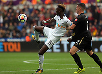 Tammy Abraham of Swansea City challenged by Ciaran Clark of Newcastle United during the Premier League match between Swansea City and Newcastle United at The Liberty Stadium, Swansea, Wales, UK. Sunday 10 September 2017