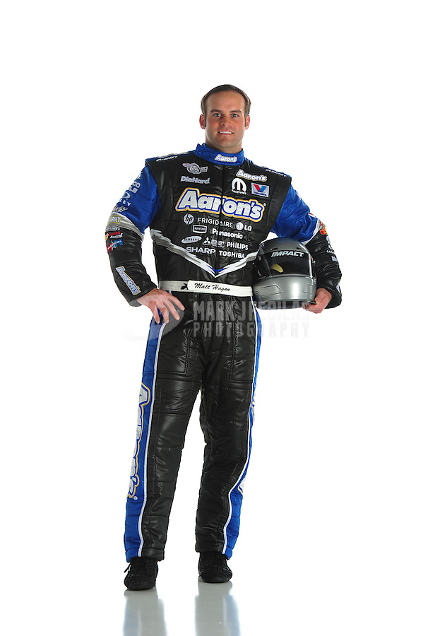 Jan. 8, 2012; Brownsburg, IN, USA; NHRA funny car driver Matt Hagan poses for a portrait during a photo shoot at the Don Schumacher Racing shop.  Mandatory Credit: Mark J. Rebilas-