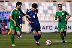 Minamino Takumi of Japan (C) is challenged by Ylyasov Vezirgeldi of Turkmenistan (L) during the AFC Asian Cup UAE 2019 Group F match between Japan (JPN) and Turkmenistan (TKM) at Al Nahyan Stadium on 09 January 2019 in Abu Dhabi, United Arab Emirates. Photo by Marcio Rodrigo Machado / Power Sport Images