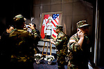 Former US soldiers stand around a portrait of General Vang Pao. Thousands from the Hmong community, former CIA and military officers mourn the loss of General Vang Pao, the start of a six-day-long funeral, in Fresno, Ca., on Friday, Feb. 4, 2011. Vang Pao led Hmong guerrillas in a CIA-backed battle against communist forces in Laos and helped tens of thousands of Hmong resettle in American cities.