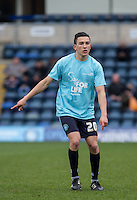 Luke O'Nien of Wycombe Wanderers warms up in his NHS Sign for Life shirt during the Sky Bet League 2 match between Wycombe Wanderers and Bristol Rovers at Adams Park, High Wycombe, England on 27 February 2016. Photo by Andy Rowland.