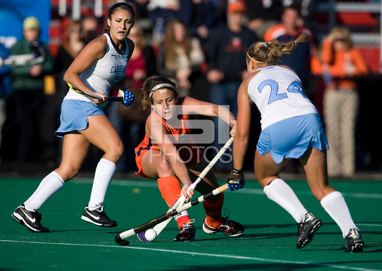 Marta Malmberg (24) of UNC takes the ball away from Haley Carpenter (3) of Virginia during the NCAA Field Hockey Championship semfinals in College Park, MD.  North Carolina defeated Virginia, 4-3, in overtime.