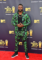 Winston Duke at the 2018 MTV Movie &amp; TV Awards at the Barker Hanger, Santa Monica, USA 16 June 2018<br /> Picture: Paul Smith/Featureflash/SilverHub 0208 004 5359 sales@silverhubmedia.com