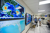 NWA Democrat-Gazette/CHARLIE KAIJO Screens are displayed showing the trajectory of Hurricane Irma at the Wal-Mart Home and Office Emergency Operations Center in Bentonville, AR on Friday, September, 8, 2017. The Wal-Mart Emergency Operations Center (EOC) has been a hub of activity the past couple of weeks because of the Hurricane Harvey and Hurricane Irma.
