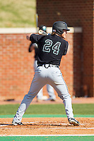 Colin Hering (24) of the Coastal Carolina Chanticleers at bat against the High Point Panthers at Willard Stadium on March 15, 2014 in High Point, North Carolina.  The Chanticleers defeated the Panthers 1-0 in the first game of a double-header.  (Brian Westerholt/Four Seam Images)