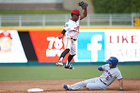 Samad Taylor (1) of the Lansing Lugnuts jumps for a high throw as Christian Donahue (5) of the South Bend Cubs slides into second base at Cooley Law School Stadium on June 15, 2018 in Lansing, Michigan. The Lugnuts defeated the Cubs 6-4.  (Brian Westerholt/Four Seam Images)