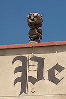 Small African statue on the top of a building in Swakopmund, Namibia