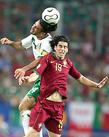 Rafa Marquez (4) of Mexico heads away from Tiago (19) of Portugal. Portugal defeated Mexico 2-1 in their FIFA World Cup Group D match at FIFA World Cup Stadium, Gelsenkirchen, Germany, June 21, 2006.