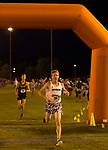 Jared Marchegger (16) crosses the finish line for the Nevada Men's Cross Country team as they compete for the first time in 25 years in the Bonanza Casino Nevada Twilight Classic season opener at Mira Loma Park in Reno on Friday night, August 30, 2019.
