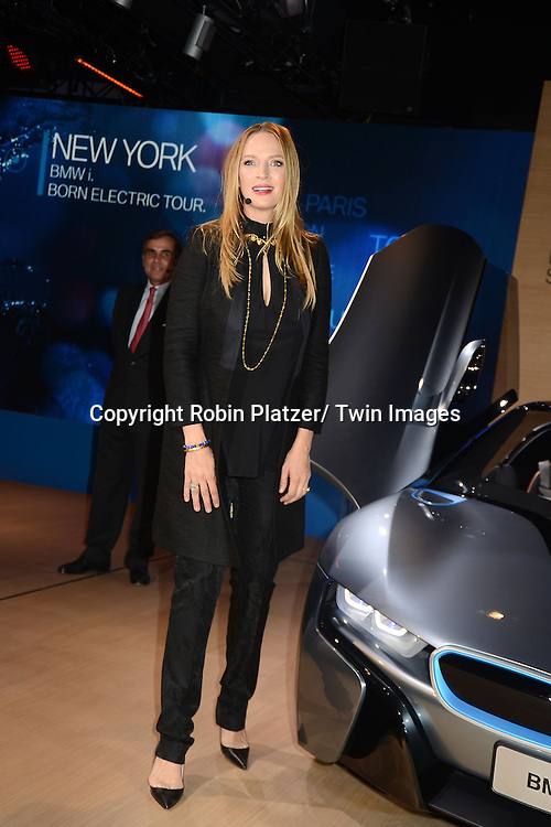 Uma Thurman unveils the new BMW i8 Concept Roadster to North America on November 12, 2012 at 1095 Avenue of the Americas in New York City. BMW of North America President and CEO Ludwig Willlisch was also at the unveiling.