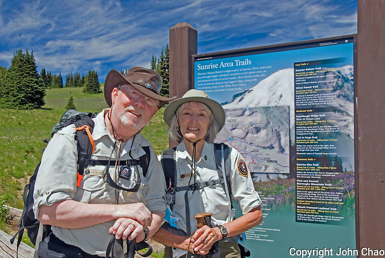 Volunteer Meadow Rovers pose by the Sunrise area trailheads in Mount Rainier National Park, Washington State. Gary Knudson & Martha Scoville are dedicated, veteran Volunteers who together have regularly patrolled trails throughout the Park for many years.